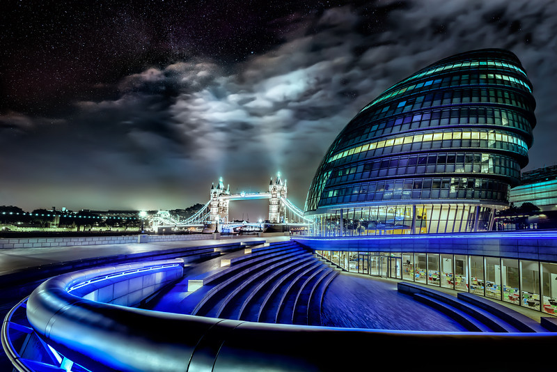 London City Hall with the London Tower Bridge just after midnight. Only a few people hovers around the area. The stars are peaking out from the skies. Photo by: Jacob Surland, www.caughtinpixels.com