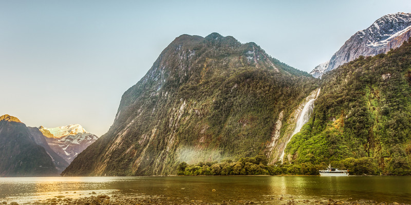 This photo was the last photo after about an hour of photography in Milford Sound in New Zealand. This boat is the first boat, one of many that will sail tourist around in the magnificent Milford Sound. Photo by: Jacob Surland, www.caughtinpixels.com