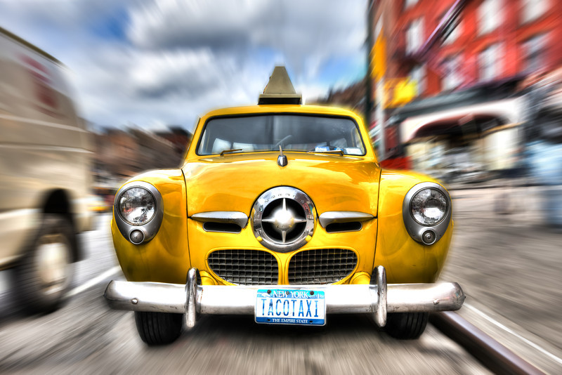 USA - New York - The ghost driver in the Taco TaxiThis got to be the coolest yellow cab in New York City. Found on 7th avenue on Manhattan. A 1950 Studebaker.