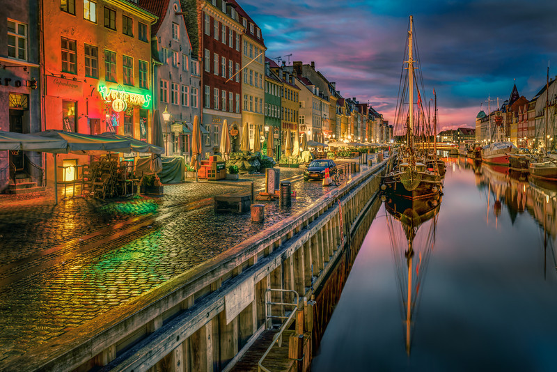 One of the major sites in lies in the heart of Copenhagen. It's called Nyhavn and means New Harbor. This is just before sunrise, before the neon lights are shut off. Photo by: Jacob Surland, www.caughtinpixels.com