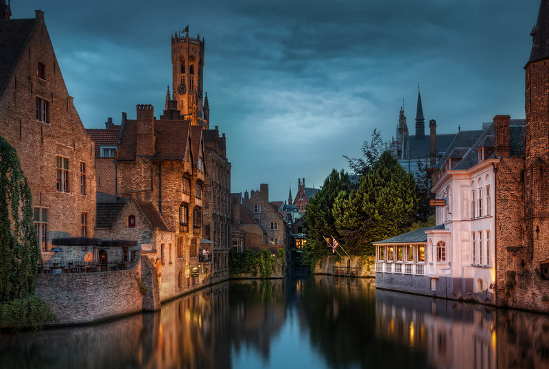 "Canal in old Middle ages town. ""In Bruges"" is the name of a movie. It refers to the old middle age town of Bruge in Belgium. Along with Amsterdam it's called the Venice of the north and it is. Photo by Jacob Surland, www.caughtinpixels.com."